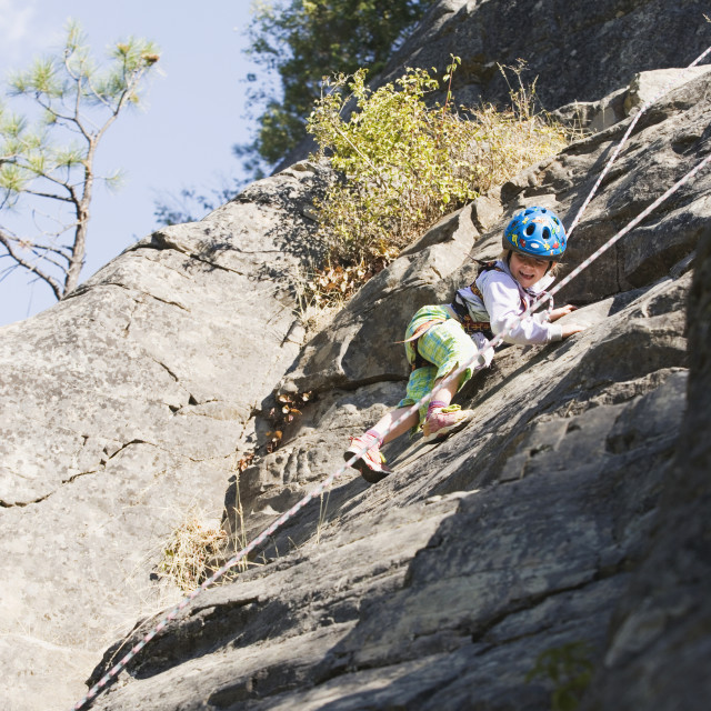 """""""Young Girl (Age 5) Climbing On Granite Cliff At Stone Hills Near Rexford,..."""" stock image"""