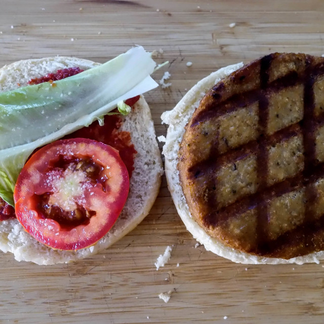 """Preparation of a fresh Chicken Burger"" stock image"