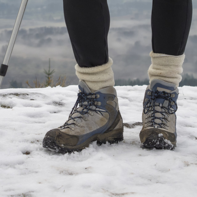 """A woman hikes in the snow on the hills of Vancouver Island; Duncan, British..."" stock image"