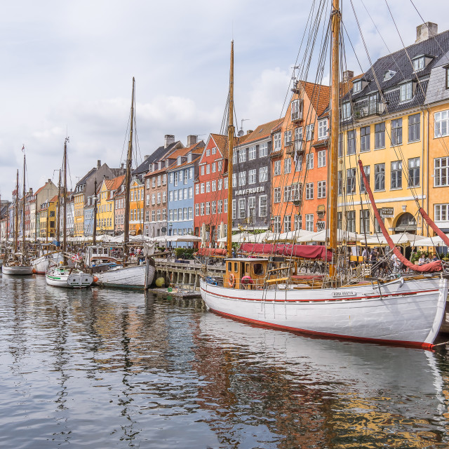 """Reflections in the water of sailing boats in Nyhavn harbor, Cope"" stock image"