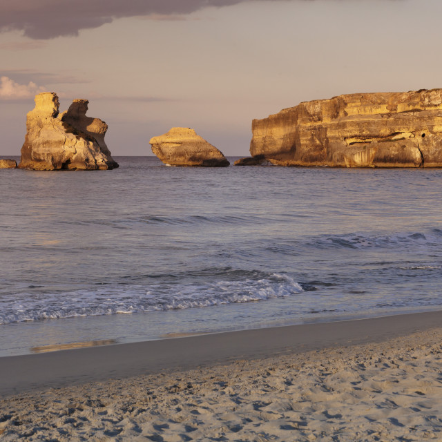 """Rocky coast near Torre dell'Orso, Due Sorello Rocks (Two sisters) at sunset,..."" stock image"
