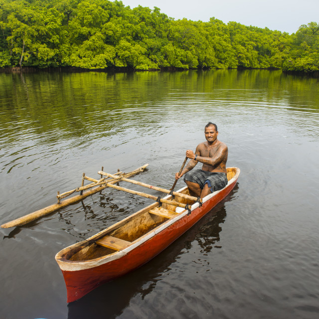"""""""Man in his dugout canoe, Kosrae. Federated States of Micronesia"""" stock image"""