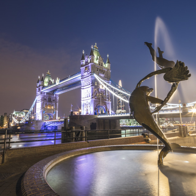 """""""The Girl With A Dolphin Fountain frames Tower Bridge reflected in the River..."""" stock image"""