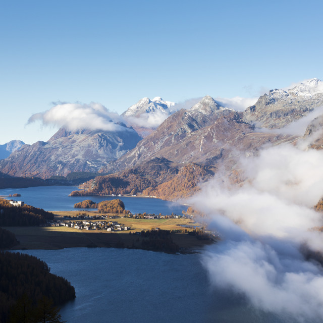 """View of Sils and the blue lake surrounded by mist in autumn, Surlej, St...."" stock image"