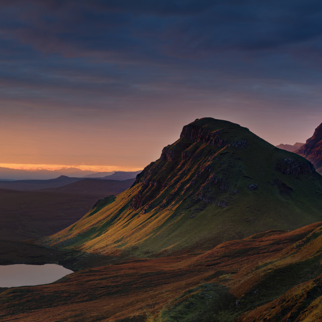 """""""First light of a new morning strikes The Cleat on the Trotternish peninsula,..."""" stock image"""