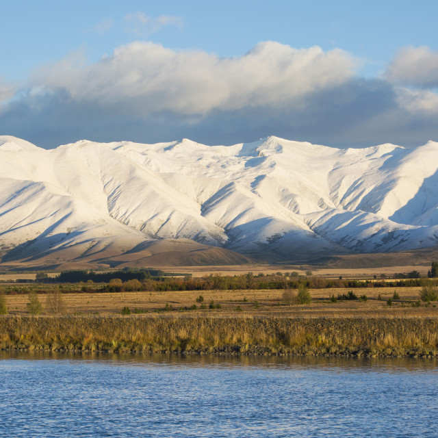 """The Ben Ohau Range cloaked in autumn snow, the Pukaki Canal in foreground,..."" stock image"