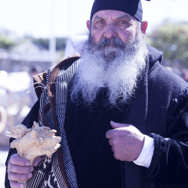 """""""Man wearing the traditional Berritta Sardinian hat and carring the..."""" stock image"""