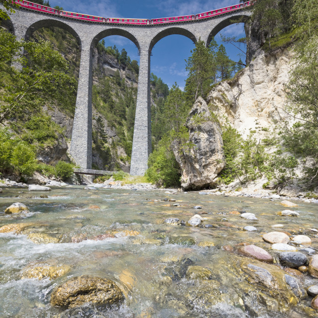"""The alpine stream frames the Bernina Express train on Landwasser Viadukt..."" stock image"