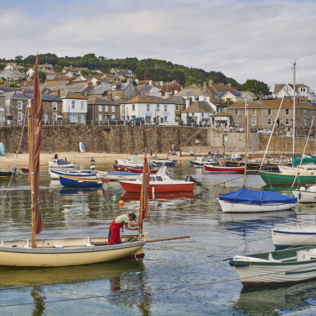 """""""A fisherman makes ready his oyster dredger before setting out from Mousehole..."""" stock image"""
