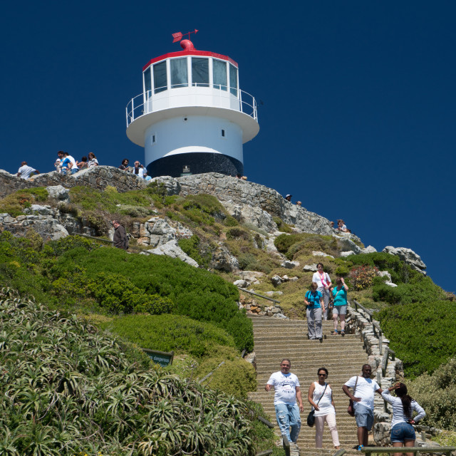 """Tourist climbing up and down steps to visit the lighthouse at Cape Point,..."" stock image"