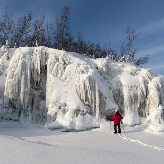 """""""A woman looking at spectacular ice formations, Tornetrask Lake, Abisko..."""" stock image"""