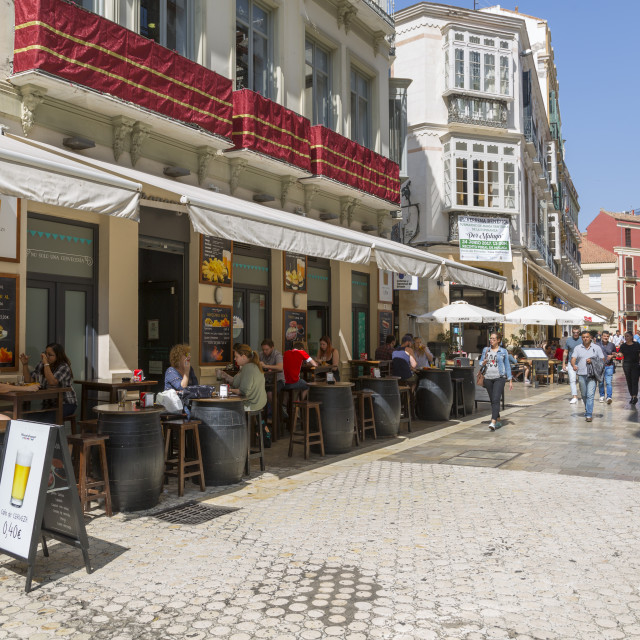 """Cafes and restaurants on Calle Granada, Malaga, Costa Del Sol, Andalusia,..."" stock image"