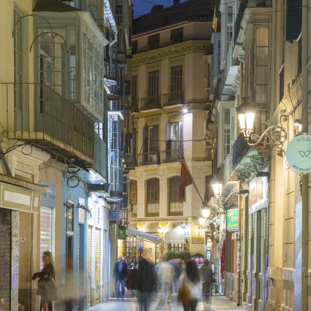 """""""Cafes and restaurants on Calle Granada at dusk, Malaga, Costa Del Sol,..."""" stock image"""