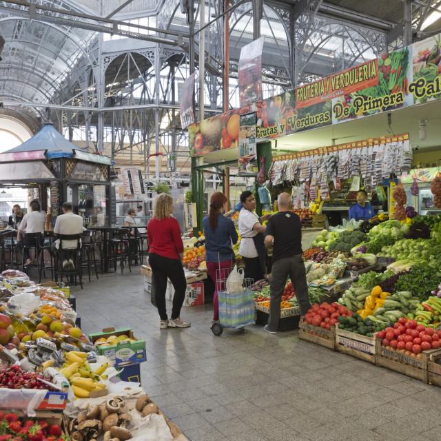 """Fruit and vegetable stalls inside wrought iron interior of Mercado de San..."" stock image"