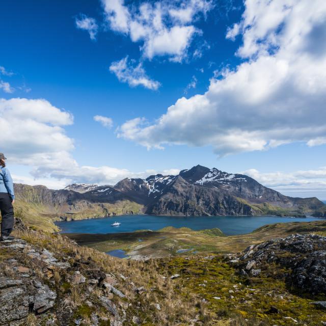 """Tourists admiring the stunning scenery of Godthul, South Georgia, Antarctica,..."" stock image"