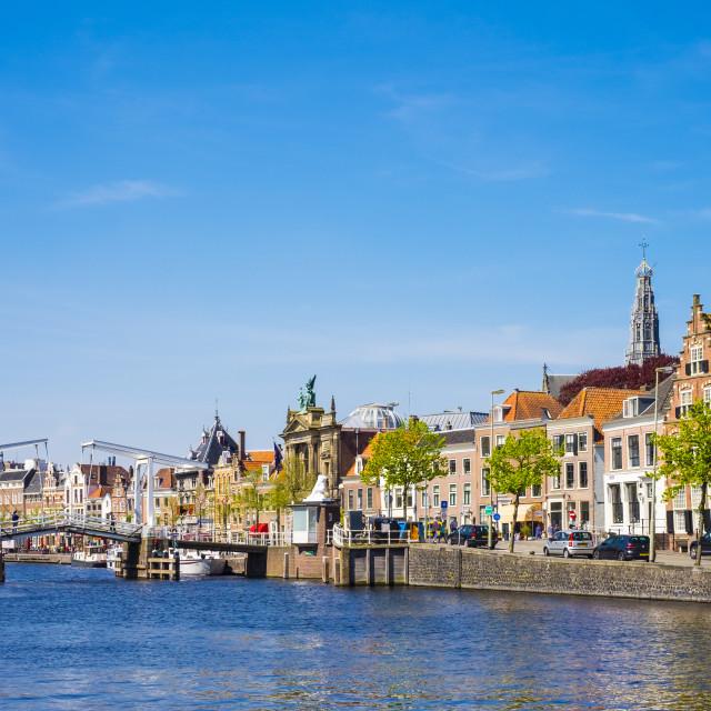 """Buildings along the Spaarne River with Gravestenenbrug drawbridge, Haarlem,..."" stock image"