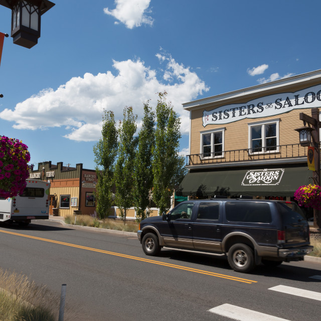 """Cars in a traditional street in the historic city of Sisters in Deschutes County"" stock image"