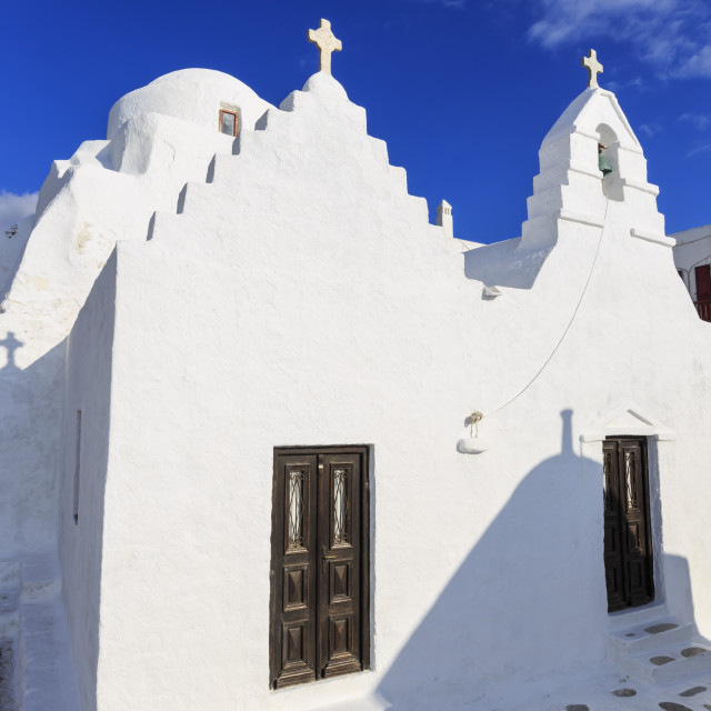 """Whitewashed Panagia Paraportiani, Mykonos most famous church, under a blue..."" stock image"