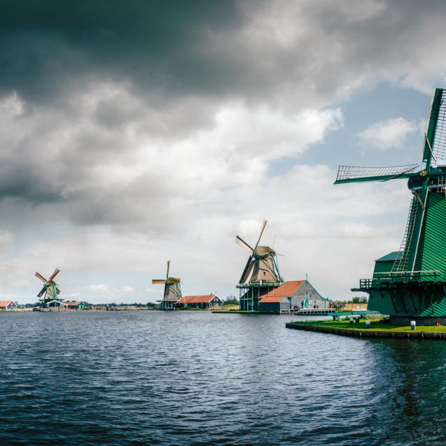 """Panoramic view of Authentic Zaandam mills in Zaanstad village on the river Zaan."" stock image"