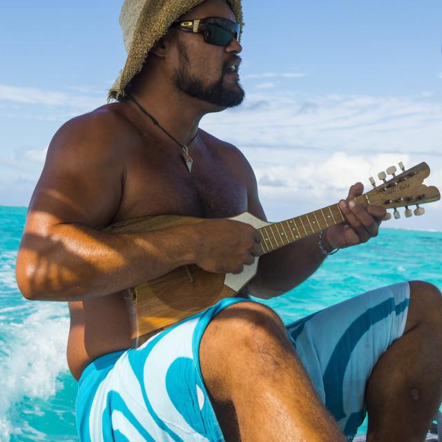 """""""Local man playing the Ukulele, Bora Bora, French Polynesia"""" stock image"""