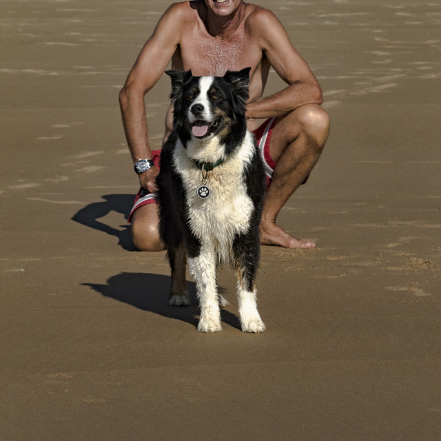 """""""Man and his best friend on the beach"""" stock image"""