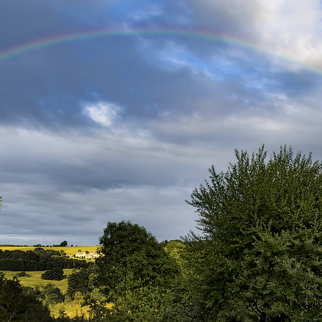 """Rainbow over Snowshill"" stock image"