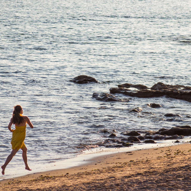 """Running in the beach"" stock image"