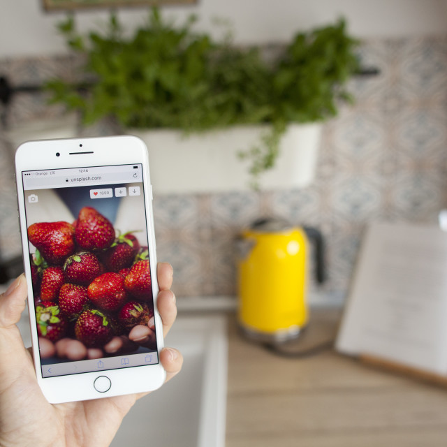 """iPhone 7 Plus in the kitchen"" stock image"