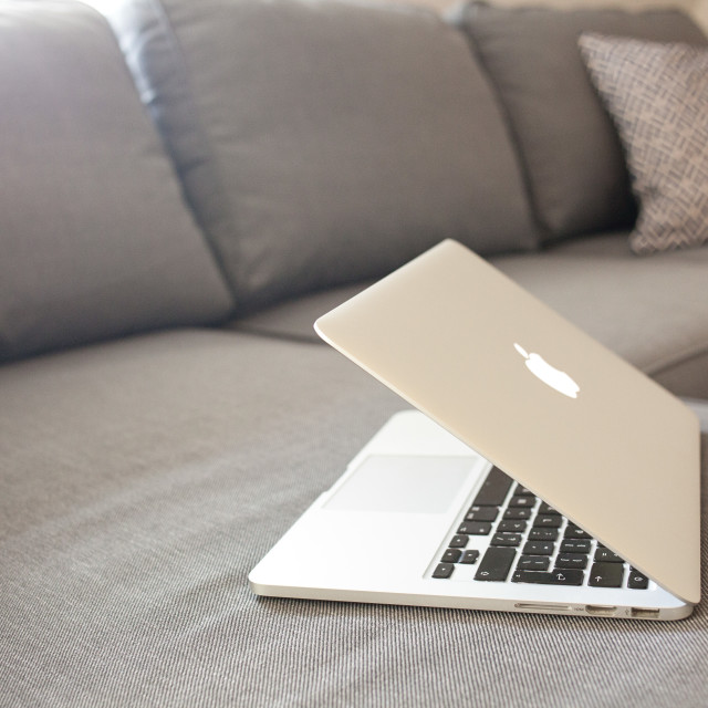 """Macbook Pro on the sofa"" stock image"