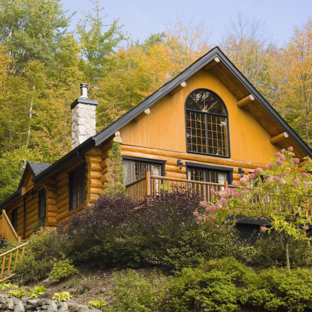 """A Log House Surrounded By Trees In Autumn; Quebec, Canada"" stock image"