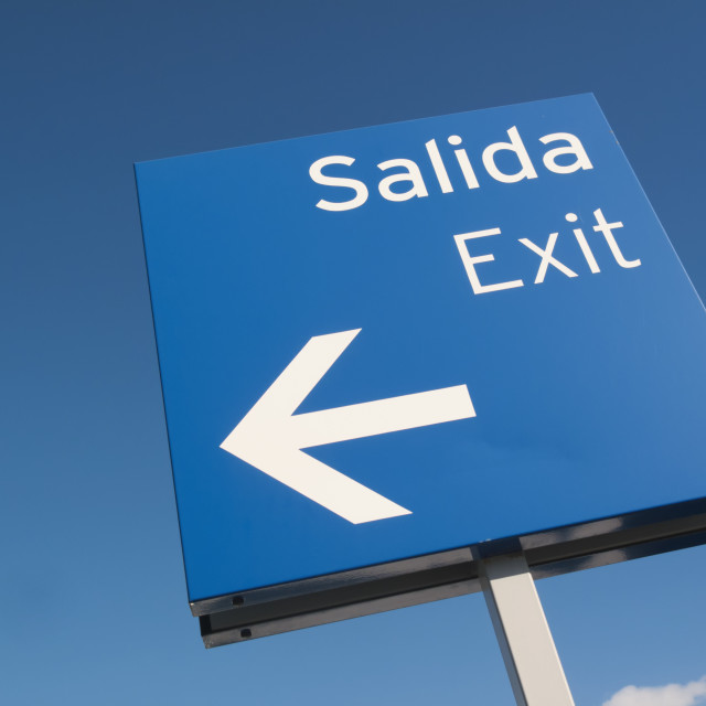 """Bilingual Spanish/English Exit Road Sign; Fuengirola, Malaga, Spain"" stock image"