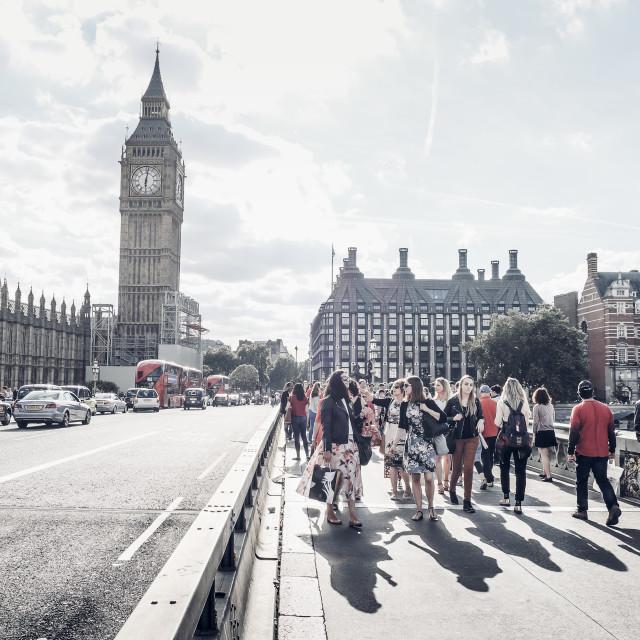 """Tourists walk on Westminster Bridge"" stock image"