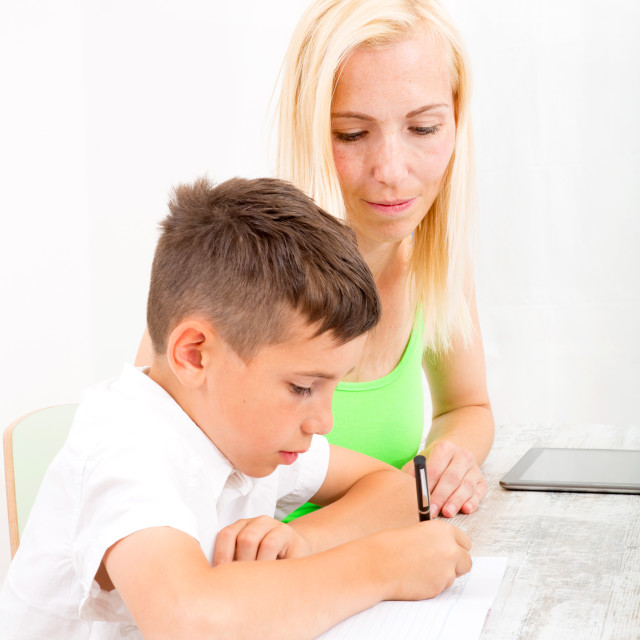 """Mother and son doing homework"" stock image"