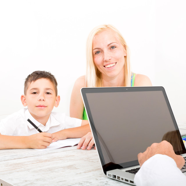 """""""Mother and son doing homework"""" stock image"""