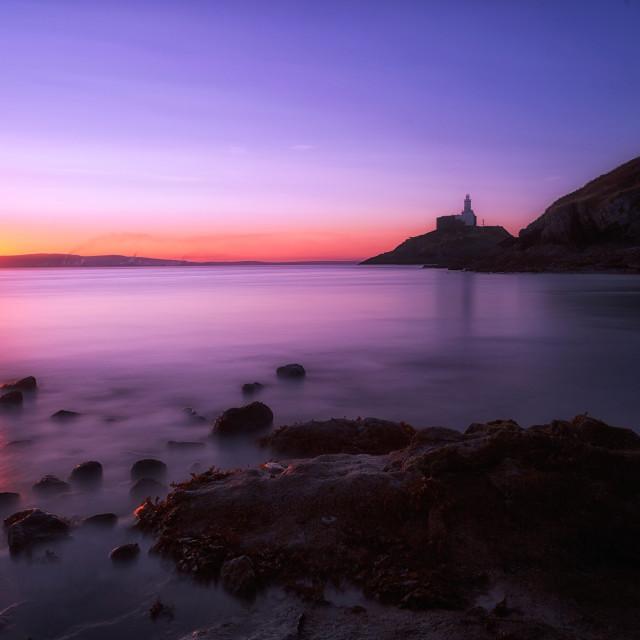 """""""Sunrise at Mumbles lighthouse"""" stock image"""