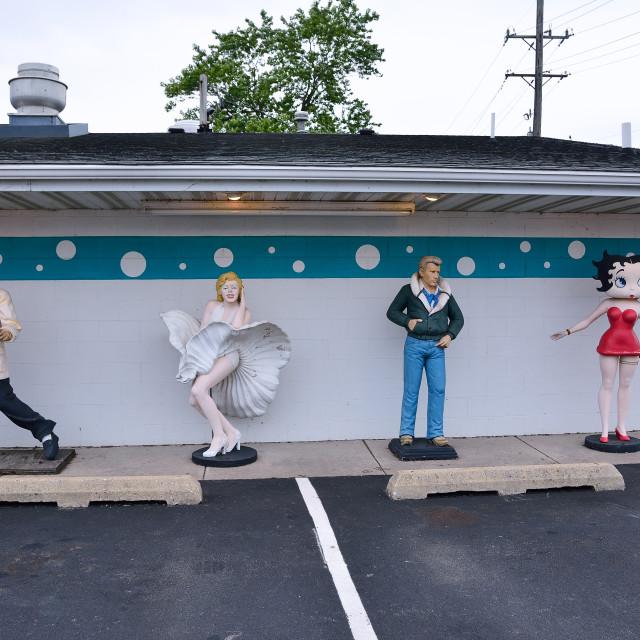"""Statues of Elvis Presley, Marilyn Monroe, James Dean, and Betty Boop."" stock image"