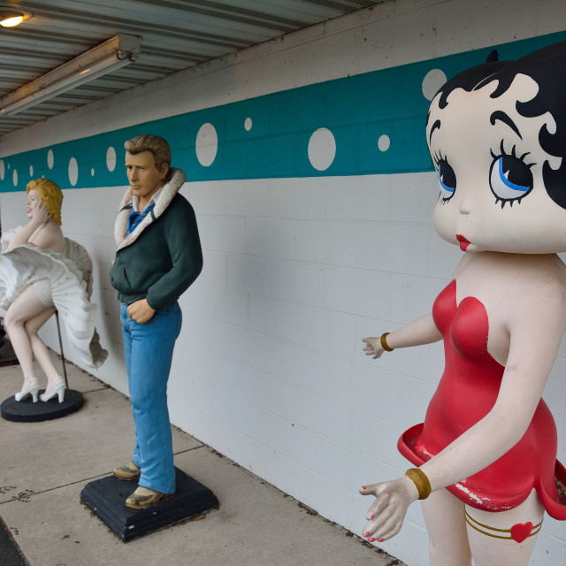 """Statues of Elvis Presley, Marilyn Monroe, James Dean, and Betty Boop."" stock image"