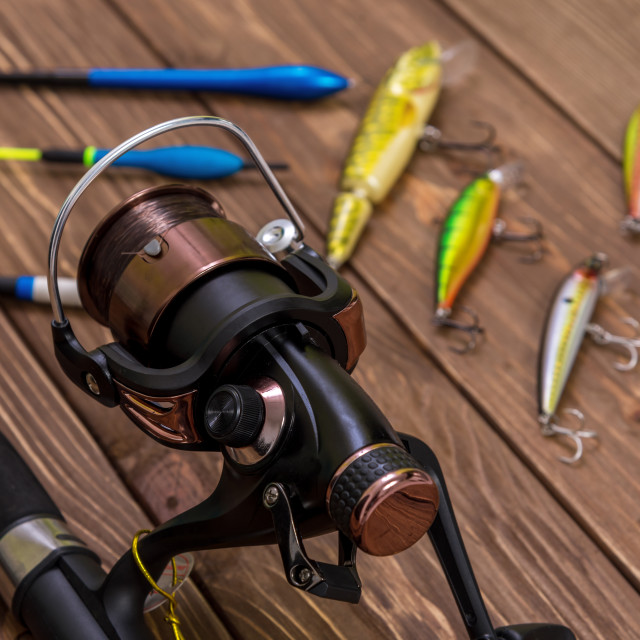 """""""Fishing tackle - fishing spinning, hooks and lures on wooden bac"""" stock image"""