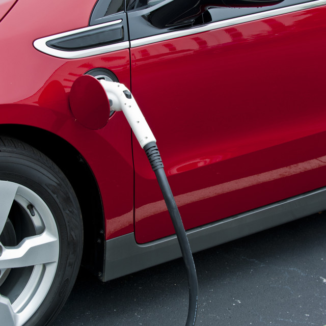 """Close up of a Chevrolet Volt car getting recharged."" stock image"