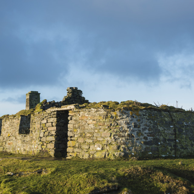 """Derelict traditional blackhouse ruin near coast, Berneray, Outer Hebrides,..."" stock image"