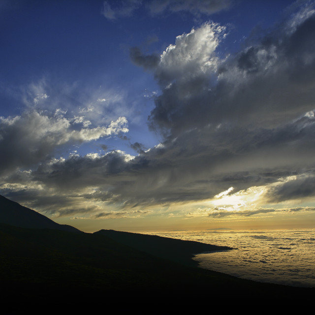 """Scenic View Of Ocean And Silhouetted Mountain In Teide National Park"" stock image"