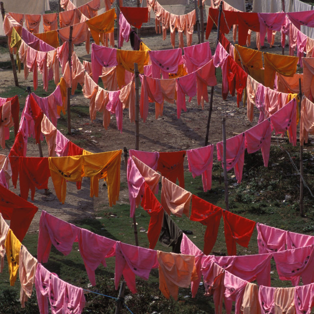 """Dyed clothes hang at Roopgonj, Bangladesh."" stock image"