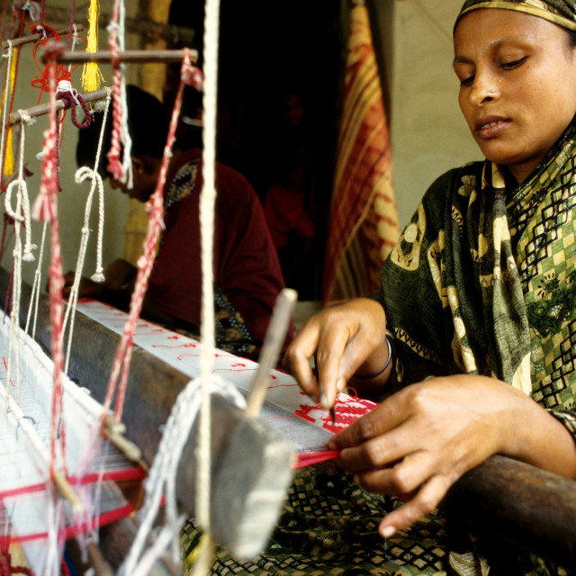 """A woman weaves cloth, an age-old tradition of Bangladesh, in villages..."" stock image"
