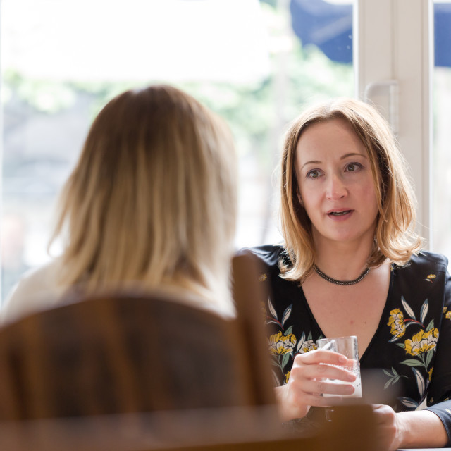 """""""Young adult woman listen to opponent at informal business meetin"""" stock image"""