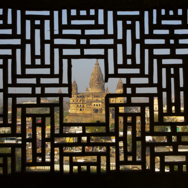 """View Of Temple Through Carved Stone Screen Window Of Rajput Palace"" stock image"