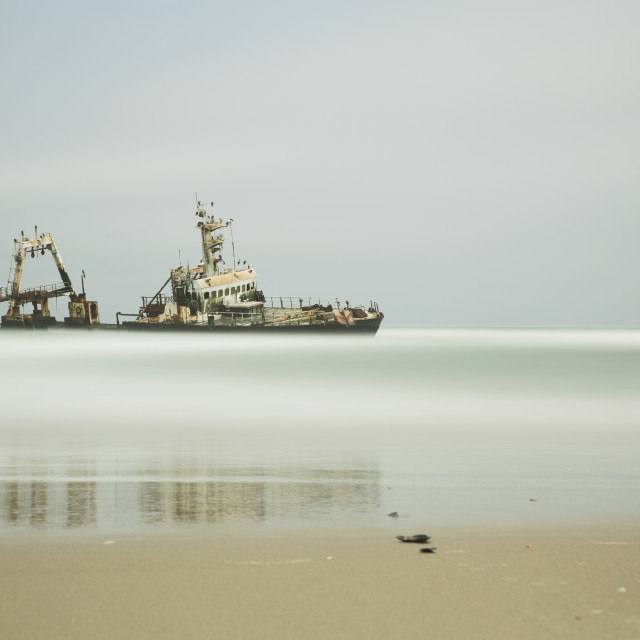 """Long Exposure Of An Unnamed Shipwreck Along The Skeleton Coast; Namibia"" stock image"
