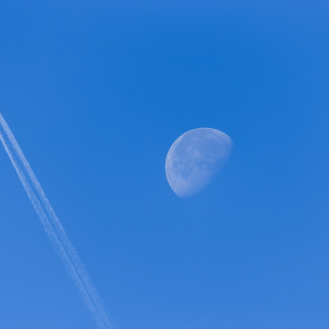 """""""Airliner Passing In Front Of The Waning Moon; South Dakota, United States Of..."""" stock image"""