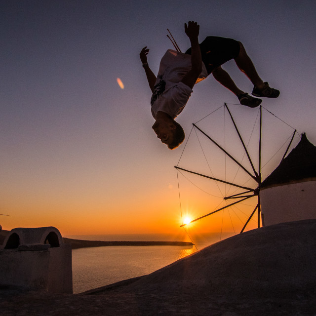 """Santorini Sunset Backflip!"" stock image"