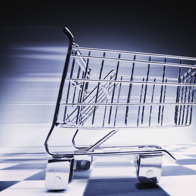 """Fast-Moving Supermarket Cart"" stock image"