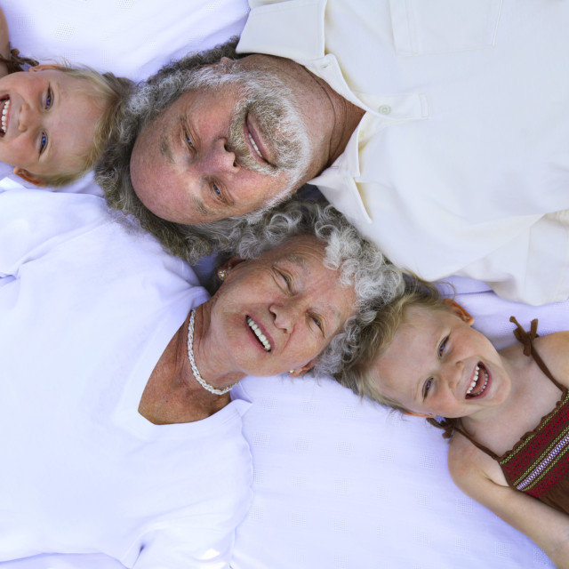 """Grandparents With Their Granddaughters"" stock image"